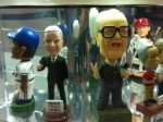 D-backs broadcaster Greg Schulte has a bobblehead located next to legendary Harry Caray.